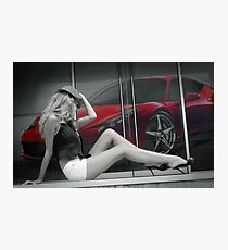 Attractive long leggy blond girl sitting in front of red Ferrari Photographic Print