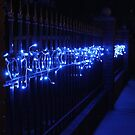 Blue Lights on a Fence by Lorin Richter