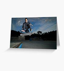 Skateboarder on a flip trick Greeting Card