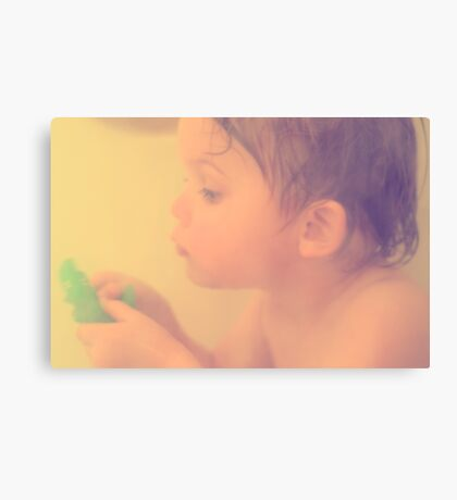 Toddler at bath with alligator toy Canvas Print