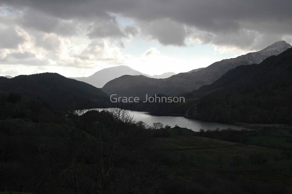 Dramatic backlight of stormy welsh mountains by Grace Johnson