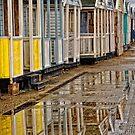 Reflection of Beach Huts by Karen  Betts