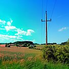 Clouds, a powerline and lots of green by Patrick Jobst