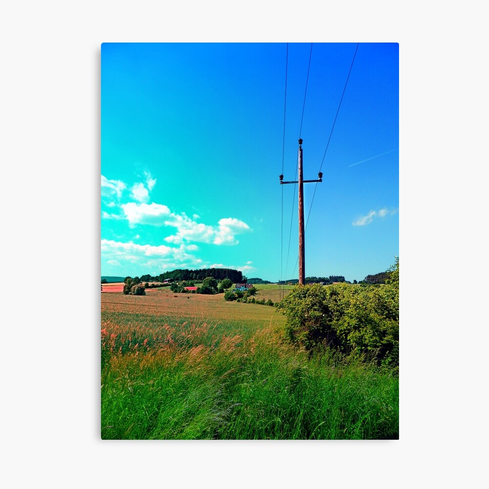 Clouds, a powerline and lots of green Canvas Print