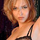 Beautiful blond woman in black bra by Anton Oparin