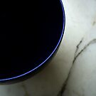 Blue bowl on marble by Elizabeth McPhee