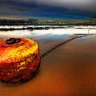 stranded stormy ornage buoy by meirionmatthias