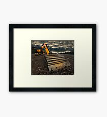 threatening and moody excavator Framed Print