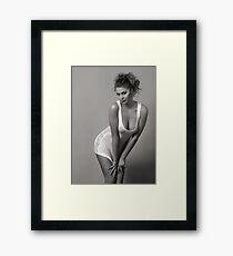 Beautiful blond girl standing in wet tee-shirt Framed Print