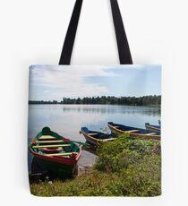 Boats on a lake Tote Bag