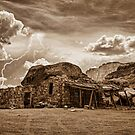 Southwest Indian Rock House and Lightning Striking Sepia by Bo Insogna