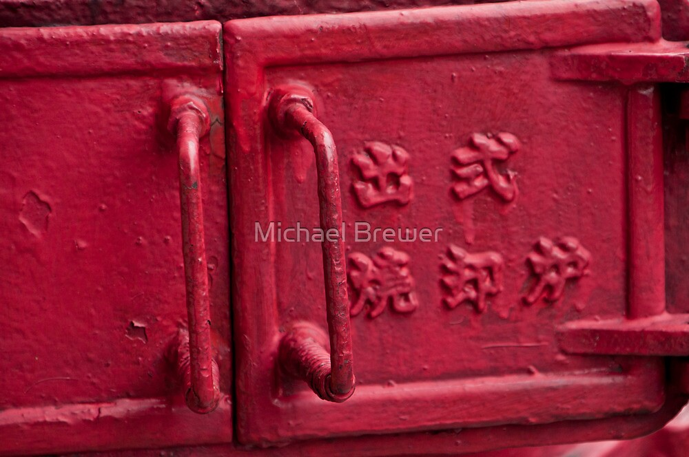 Bright red old iron street fitting seen in Singapore by Michael Brewer