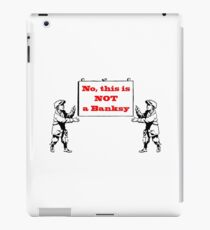 No, this is not a Banksy iPad Case/Skin