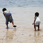 Children on the beach by Henk van Kampen