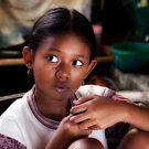 Balinese child in the Batik workshop, near Ubud, Bali. by Kristi Robertson
