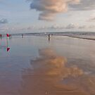 Reflection of clouds in the sand at Seminyak Beach, Bali, Indonesia by Michael Brewer