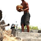 Man with the rice on Perteran Island by Michael Brewer