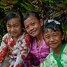 Girls in ceremonial dress at a village festival near Tabanan in Bali, Indonesia by Michael Brewer