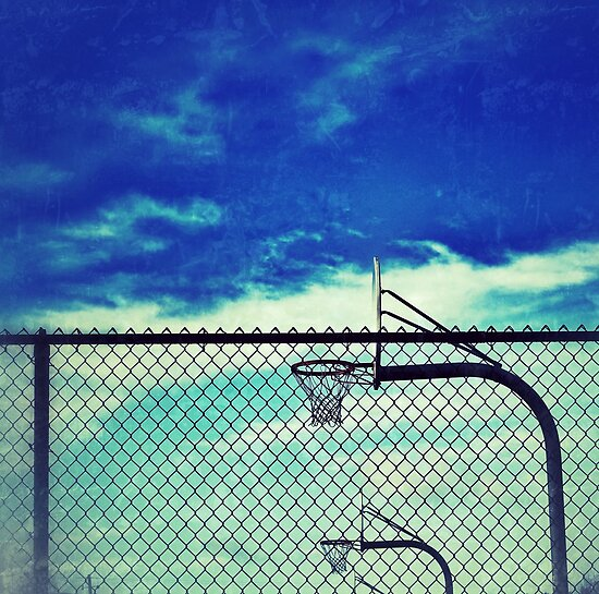 Basketball hoops inside fence at Wells Middle School, Dublin California by Dan Fitzpatrick