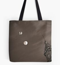 Floating above Time Tote Bag