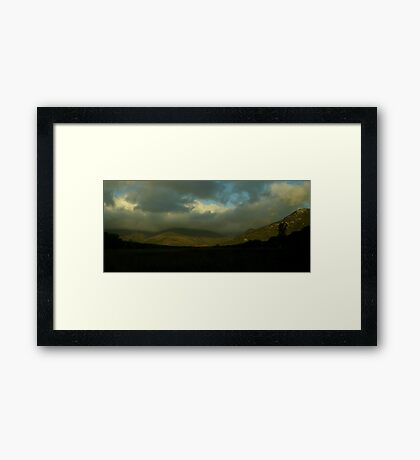 A storm brewing Framed Print