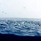 Rain drops falling into ocean by Sami Sarkis