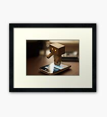 Danbo tries to use my iPhone Framed Print