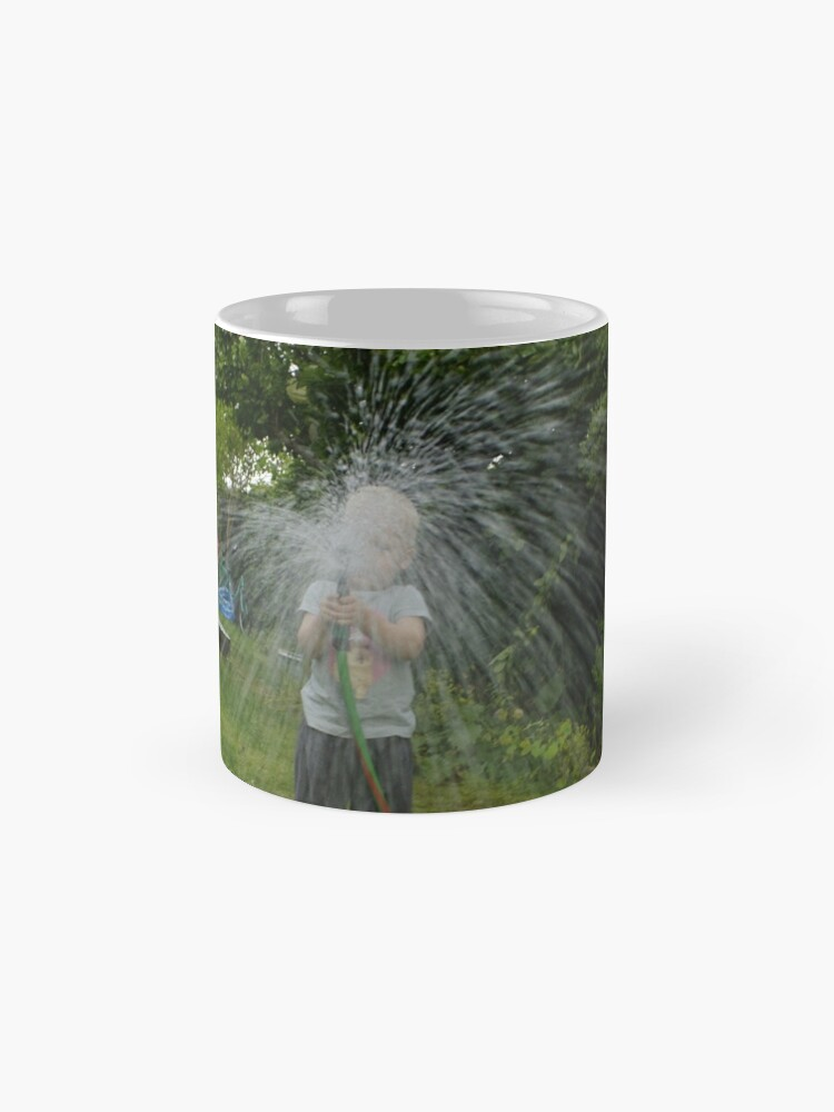 Alternate view of little girl watering the grass Mugs