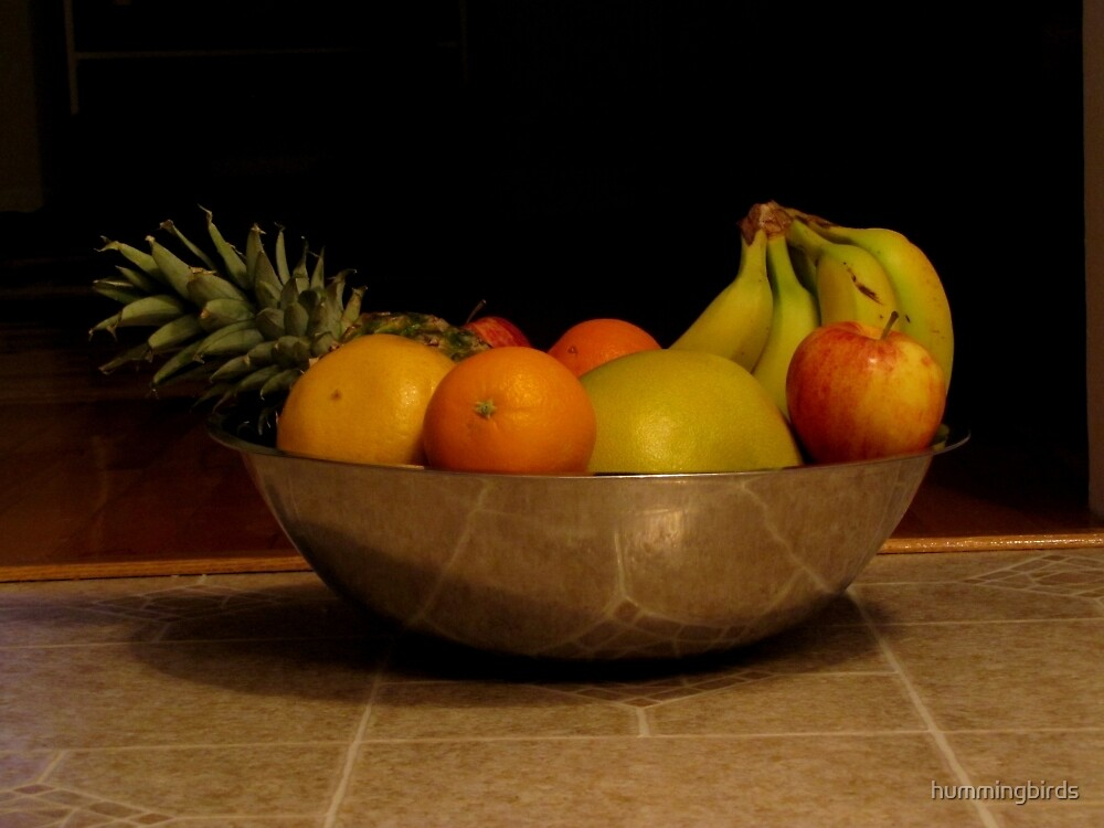 Fruit bowl still life by hummingbirds