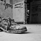Shoe in an abandoned house by George Mast