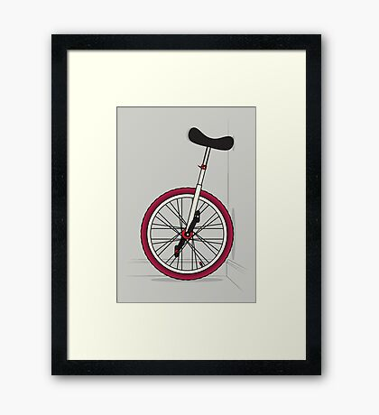 Unicycle By Wall Framed Print