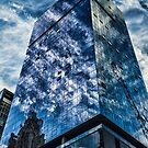 clouds reflect in modern glass architecture by Sven Brogren