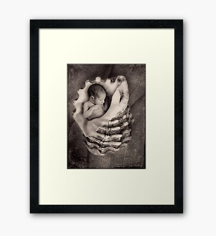 You never know what you might find on the seashore... Framed Print