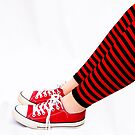 Red and black striped leg warmers by Janette Anderson