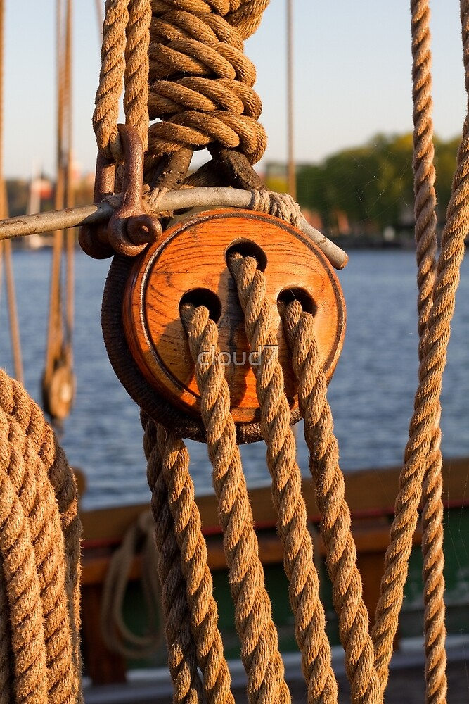 Ropes and knots on a wooden vessel. by cloud7