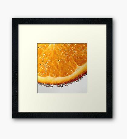 Orange in bubbles Framed Print