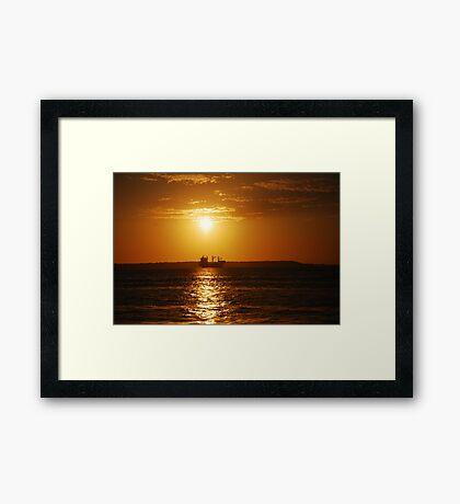 Sunset boat Framed Print