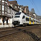 Regional train passing Bacharach, Germany by David A. L. Davies