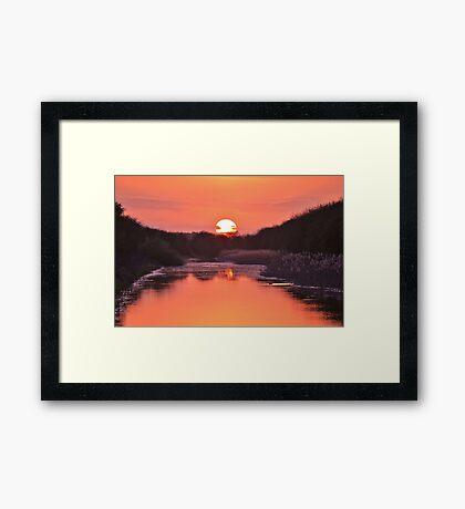 Dipping the Sunset Framed Print