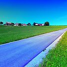 Small country road and a hill by Patrick Jobst