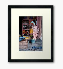 Merchant In Doorway Framed Print