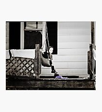 Little Amish Girl on Front Porch Swing Photographic Print