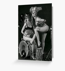 Two sexy ladies wearing masks in music club stage... Greeting Card