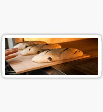 Loaves of bread in a bakery oven. Sticker