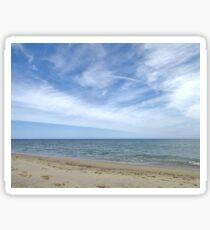Sandy ocean beach under pretty blue sky Sticker