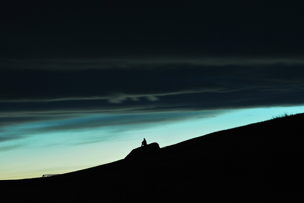 Man watching the sunset. by Derek Lafont