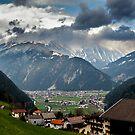 Village in alpine valley by Maxim Mayorov