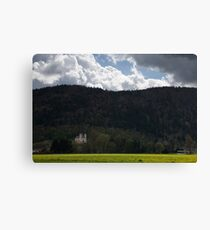 Storm clouds parting over church Canvas Print