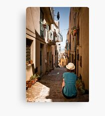small sicilian street with sitting girl Canvas Print