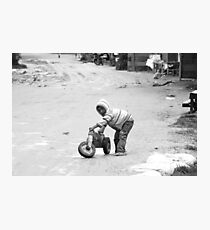 Child and his tricycle Photographic Print
